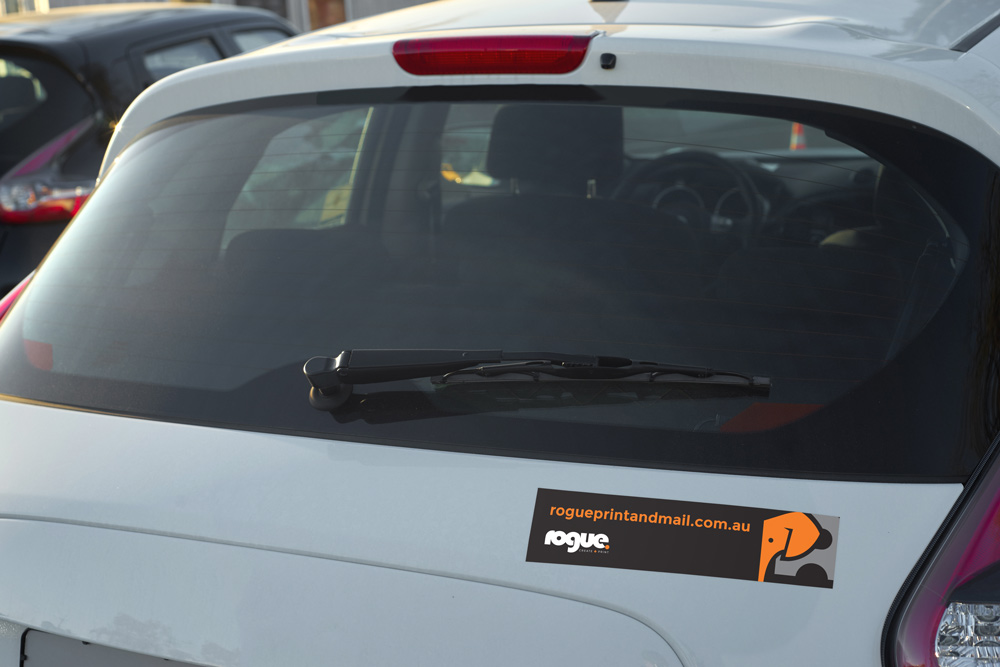 Bumper Sticker With Rogue Print And Mail On The Boot Of A Car
