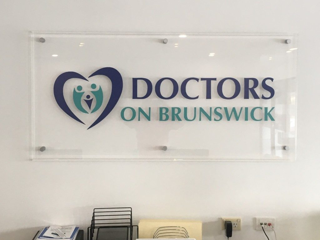 Medical centre signage mounted perspex with vinyl cut logo