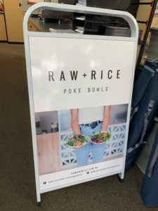 Raw and Rice printed A Frame with white aluminium frame and vinyl sticker print