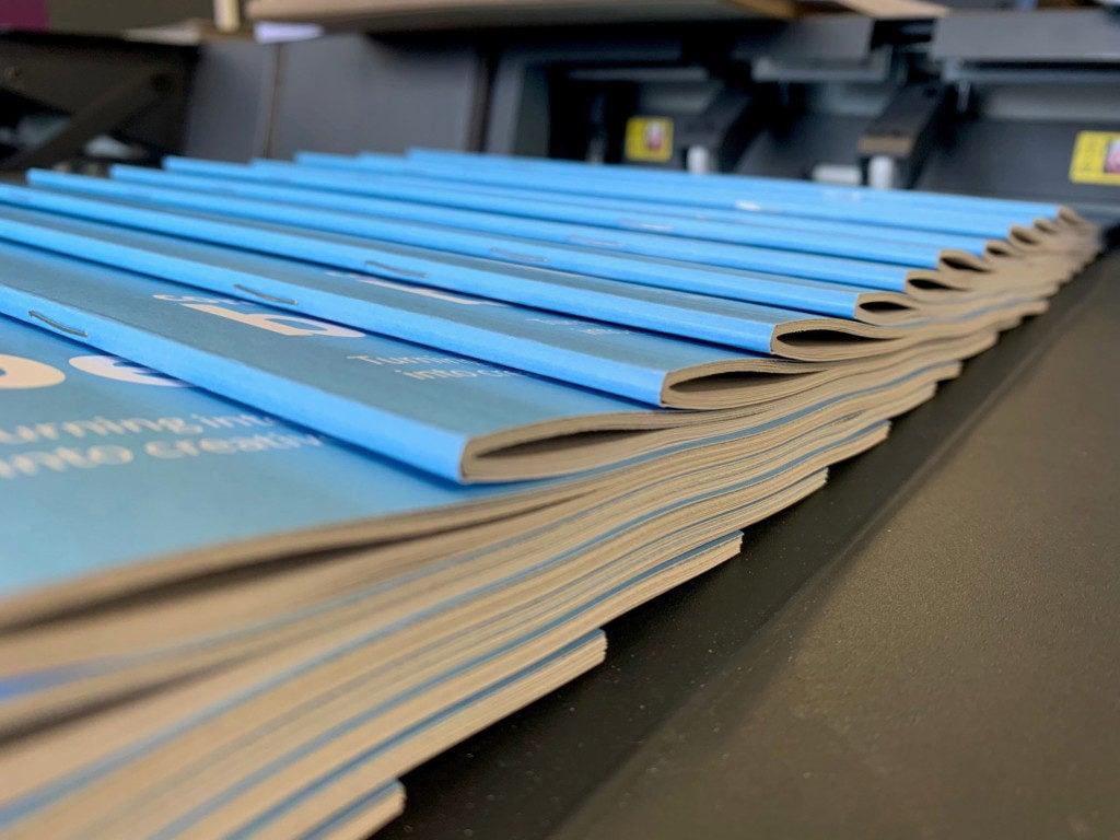 Saddle Stitched Books on the digital printing press