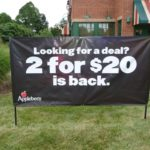 Outdoor banner with metal stands for placement into grass